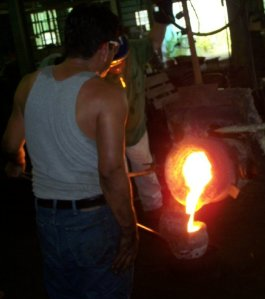 iron pouring into ladle